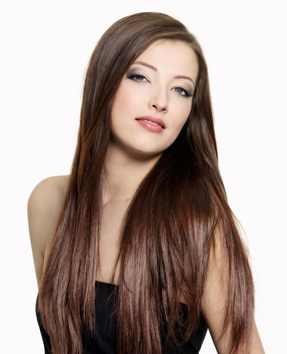 Portrait of young attractive woman with long gloss hair